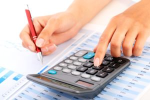 money manager calculating finances
