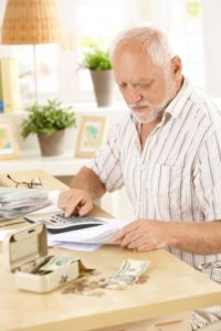 Elderly man acting as money manager and doing finances