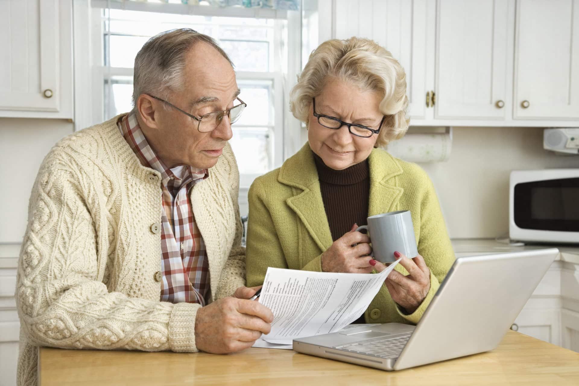 senior couple doing finances protection against financial fraud