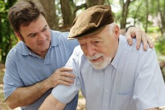 senior man and middle aged son need help with protection against financial fraud and elder abuse