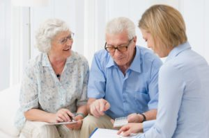 elderly couple avoiding financial threats with help from a money manager