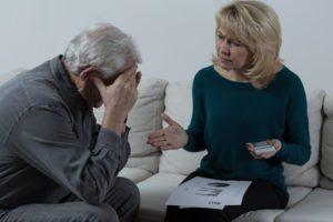 Elderly couple discussing senior money problems and finances
